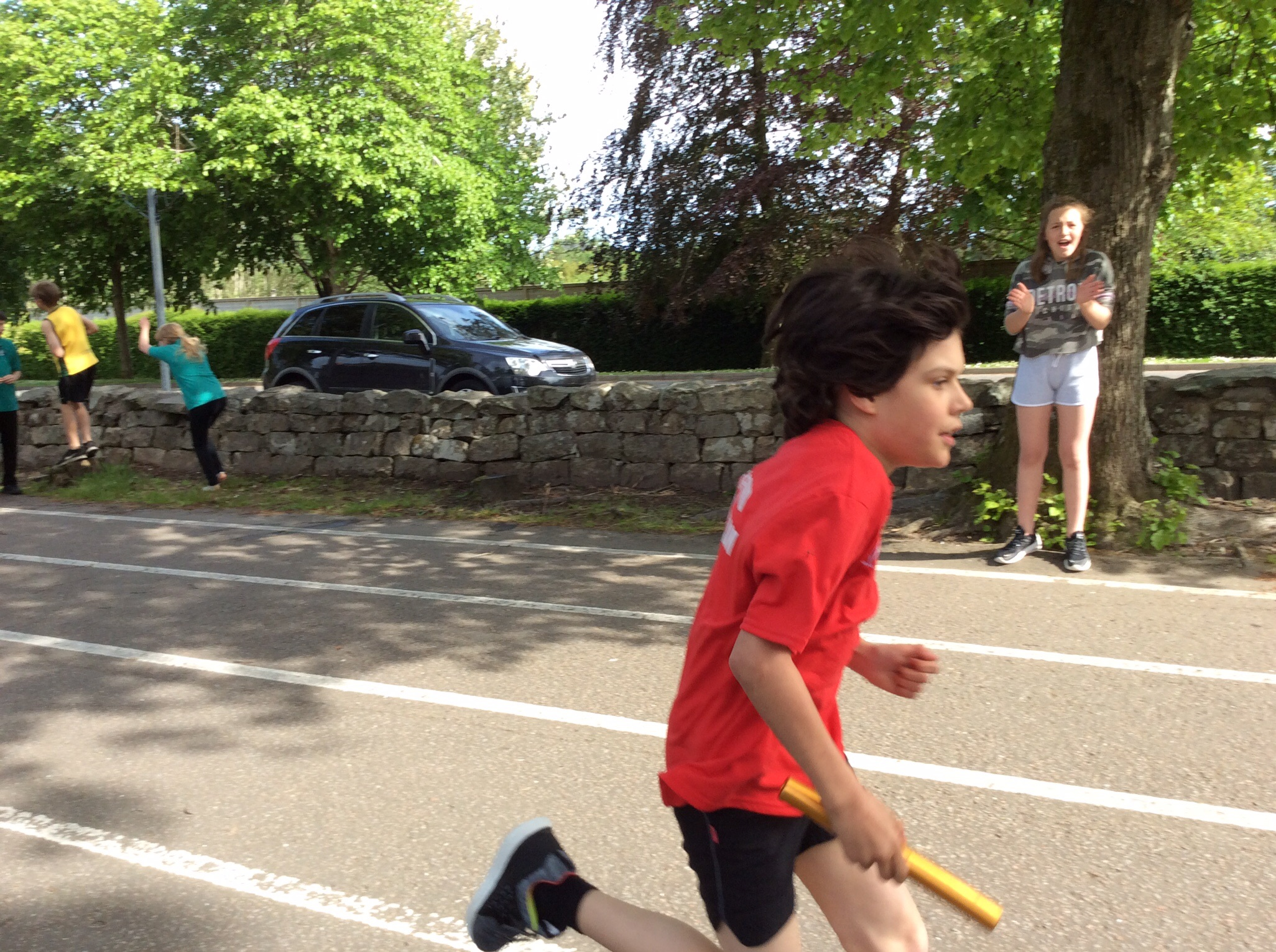 P5 Boy finishing their part of the relay
