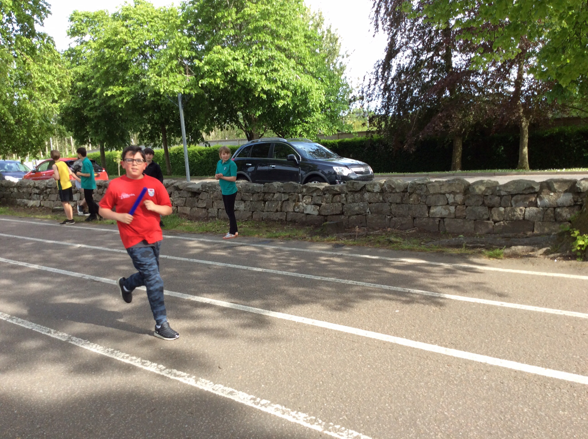 P4 Boy finishing their part of the relay