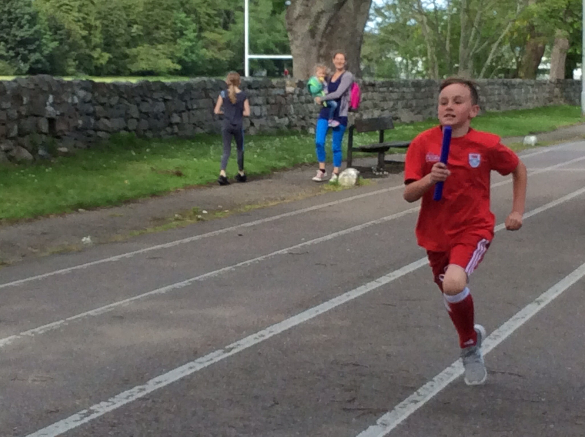 P4 Boy finishing the relay for his team