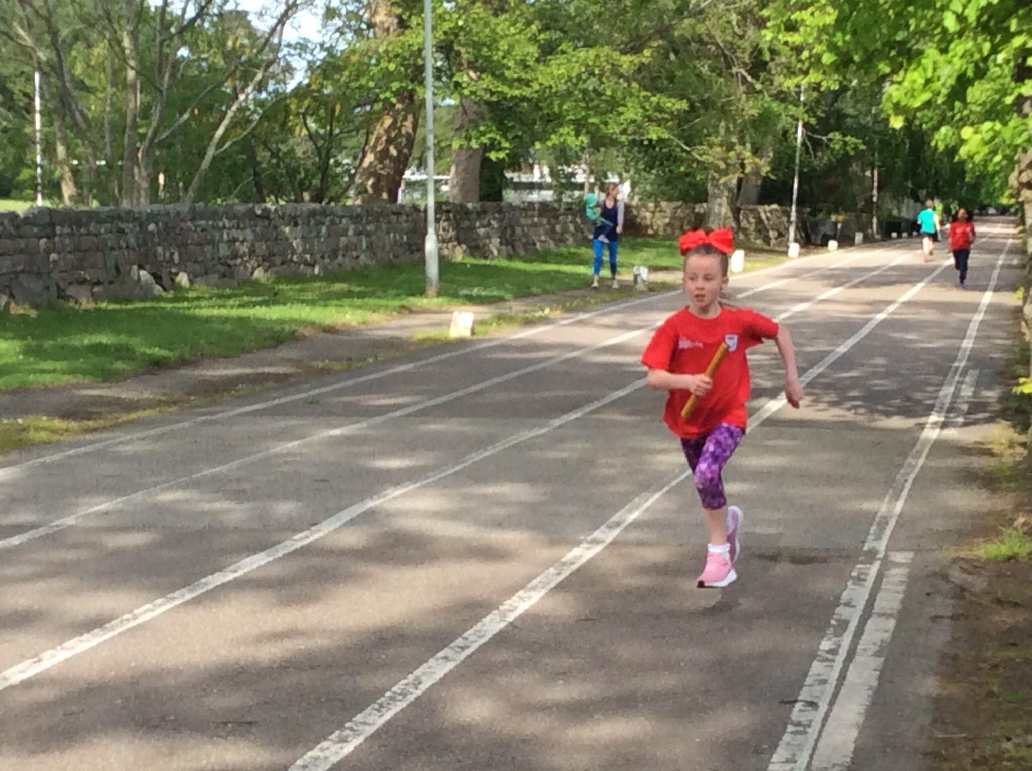 P3 Girl finishing their part of the relay